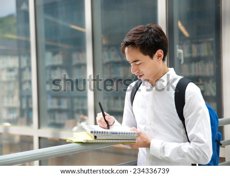 Portrait of college student at his university - stock photo