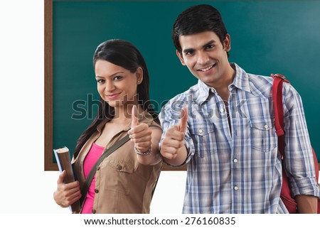 Portrait of college students gesturing - stock photo