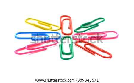 Portrait of colorful paper clips over the white background - stock photo