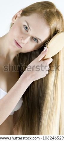 portrait of combing woman wearing underwear - stock photo