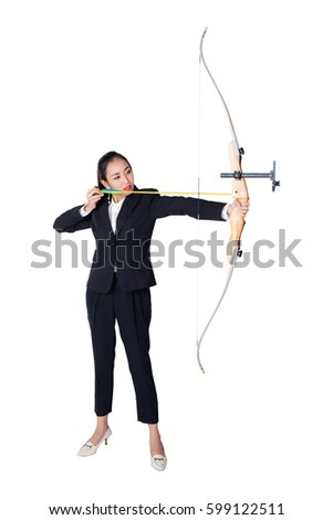 Portrait of concentrated female with crossbow in hands over white background