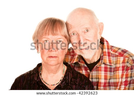 Portrait of concerned senior couple on white background - stock photo
