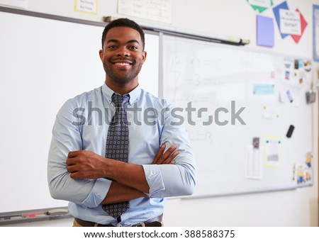 Portrait of confident African American male teacher in class - stock photo