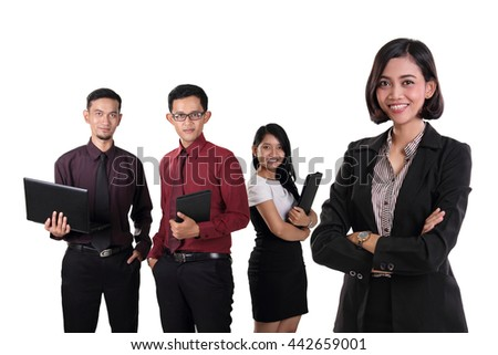 Portrait of confident Asian business manager standing with her professional coworkers on white background - stock photo