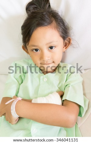 Portrait of Confident  Asian Ethnic Little Child Impatient in Hospital Smiling - stock photo