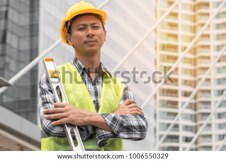 Portrait of confident asian worker standing in the site construction development.