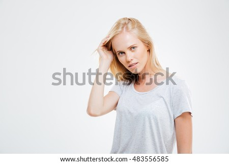 Portrait of confident beautiful young woman with blonde hair over white background