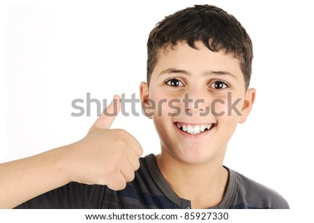 Portrait of  confident boy showing thumbs up - stock photo