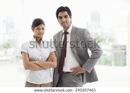 Portrait of confident business colleagues smiling together - stock photo