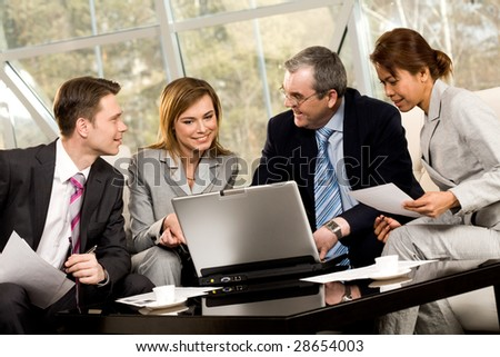 Portrait of confident business partners working at new project at meeting - stock photo