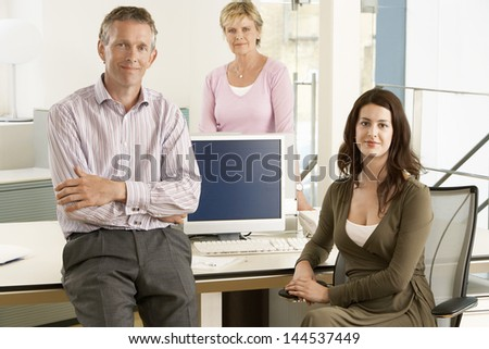 Portrait of confident business people in office - stock photo