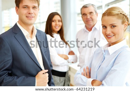 Portrait of confident business people looking at camera - stock photo