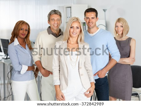 Portrait of confident business people smiling in office - stock photo