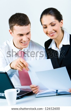 Portrait of confident business people working with documents  together