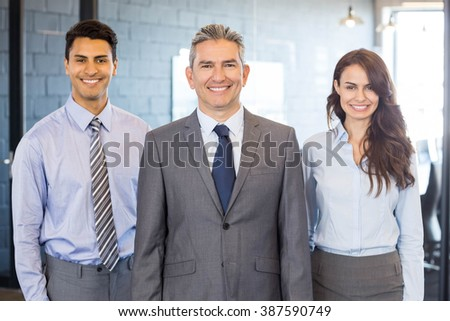 Portrait of confident business team standing in office - stock photo