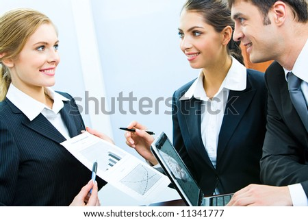 Portrait of confident business woman demonstrating a plan to her colleagues