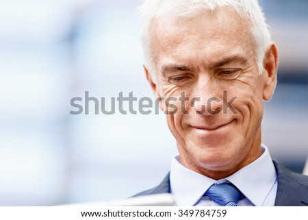 Portrait of confident businessman in suit outdoors