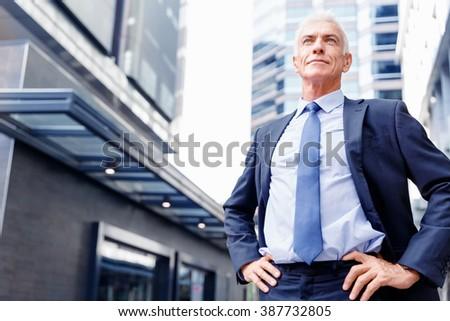 Portrait of confident businessman outdoors - stock photo