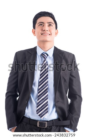 Portrait of confident businessman over white background. Looking up - stock photo