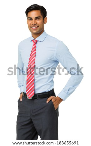 Portrait of confident businessman standing with hands in pockets against white background. Vertical shot.