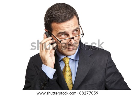 Portrait of confident businessman talking at the phone - stock photo
