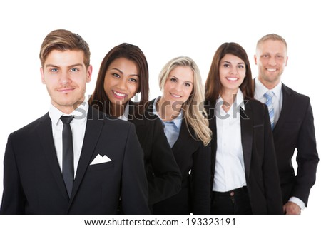 Portrait of confident businesspeople standing in a row against white background - stock photo