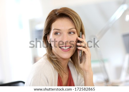 Portrait of confident businesswoman talking on the phone - stock photo