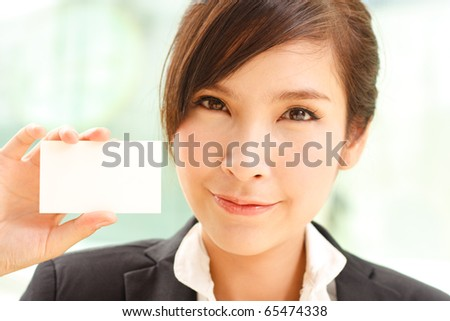 Portrait of confident businesswoman with business card