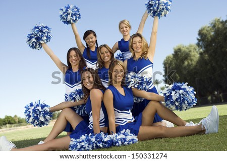 portrait confident cheerleaders holding pompoms on stock photo 150331274 shutterstock. Black Bedroom Furniture Sets. Home Design Ideas