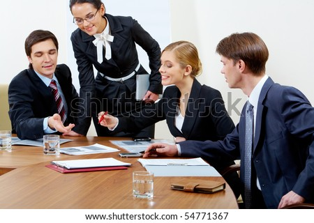 Portrait of confident co-workers discussing hottily new business plan at meeting - stock photo