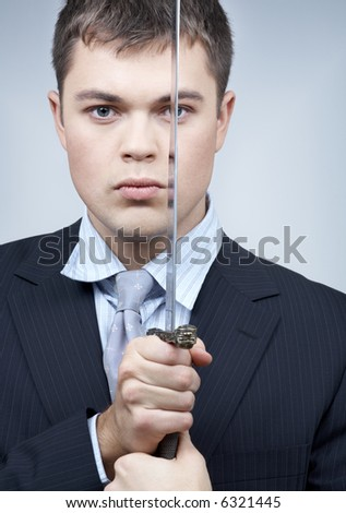 portrait of confident corporate worker with sword - stock photo