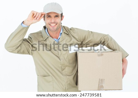 Portrait of confident delivery man carrying cardboard box over white background - stock photo