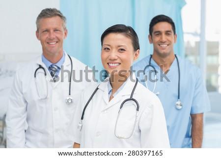 Portrait of confident doctors at hopital - stock photo