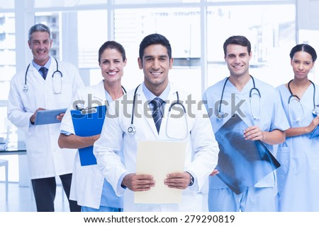 Portrait of confident doctors with arms crossed at medical office - stock photo
