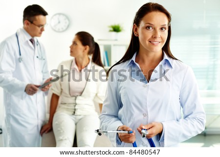 Portrait of confident female doctor looking at camera in hospital - stock photo
