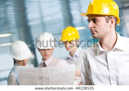 Portrait of confident foreman in helmet in working environment - stock photo