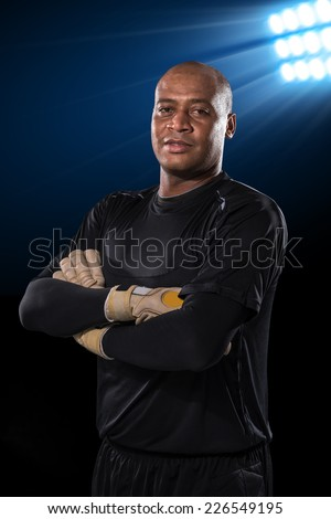 Portrait of confident goalkeeper looking at the camera - stock photo