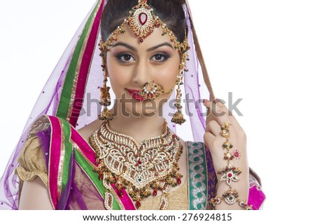 Portrait of confident Indian bride over white background - stock photo