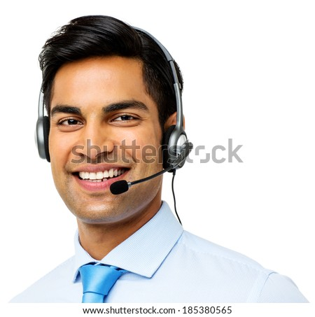 Portrait of confident male call center representative wearing headset over white background. Horizontal shot. - stock photo