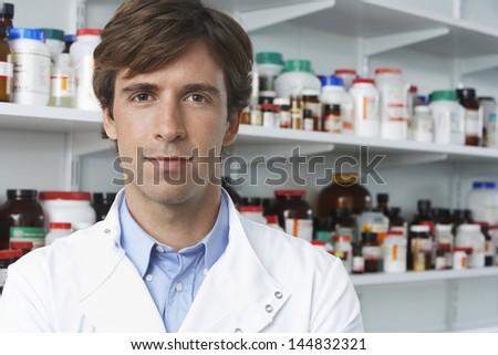 Portrait of confident male pharmacist in pharmacy - stock photo