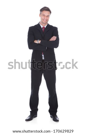 Portrait Of Confident Mature Businessman With Arm Crossed - stock photo