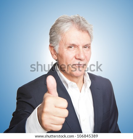 Portrait of confident mature businessman with  thumbs up - stock photo