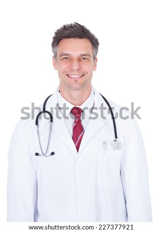 Portrait of confident mature doctor with stethoscope around neck over white background - stock photo