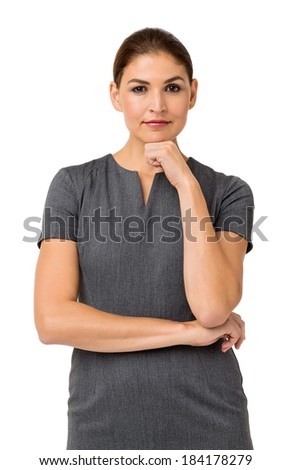 Portrait of confident mid adult businesswoman with hand on chin standing against white background. Vertical shot. - stock photo