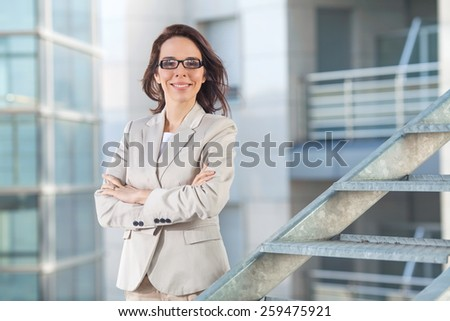 Portrait of confident mid adult businesswoman with her arms crossed. - stock photo