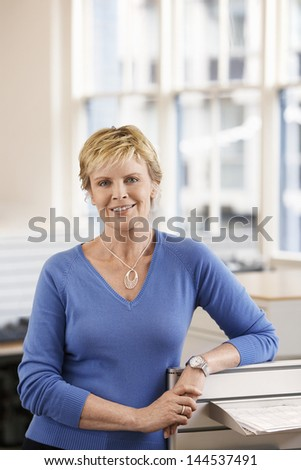 Portrait of confident middle aged businesswoman in office - stock photo