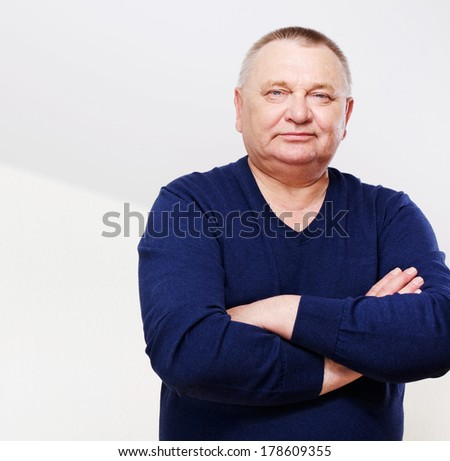 Portrait of confident middle aged man with copy space - stock photo
