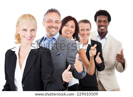 Portrait of confident multiethnic business people gesturing thumbsup over white background