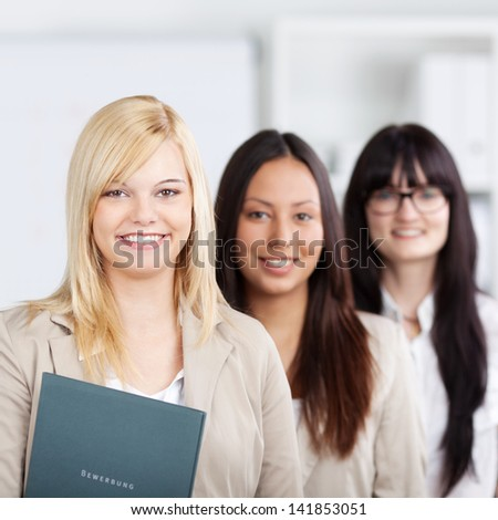 Portrait of confident multiethnic businesswomen standing together in office - stock photo