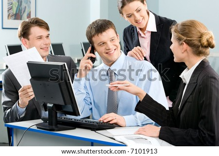 Portrait of confident people discussing a business-plan - stock photo